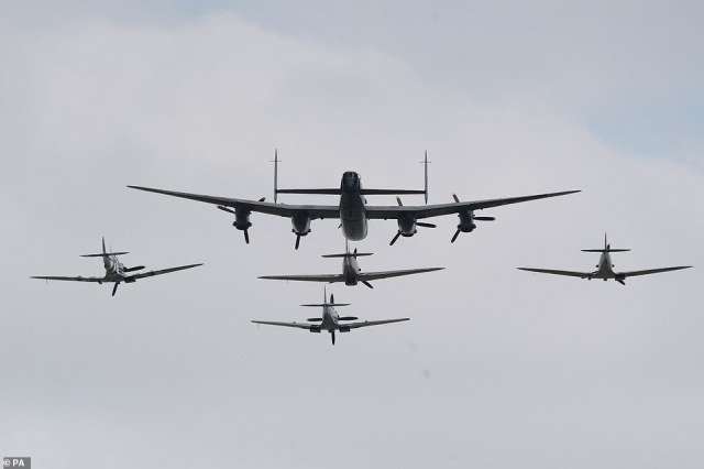 Three Spitfires, a Hurricane and a Lancaster bomber fly over the national service of remembrance marking the 75th anniversary of VJ Day at the National Memorial Arboretum in Alrewas, Staffordshire