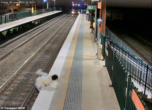 In another video a passenger runs across the tracks to get to the opposite platform to catch their train