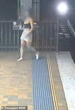 As she returns to the platform a train roars into shot, only seconds away from hitting her