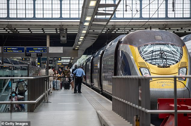 Eurostar passengers arrive at St Pancras Station in London from Paris on the first train after a quarantine was put in effect for people returning from France