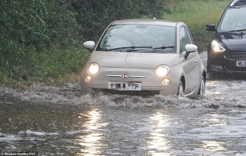 Heavy rain caused roads to flood in Chelmsford, Essex this afternoon.