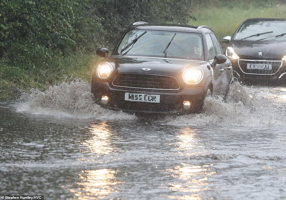 Heavy rain caused roads to flood in Chelmsford, Essex this afternoon