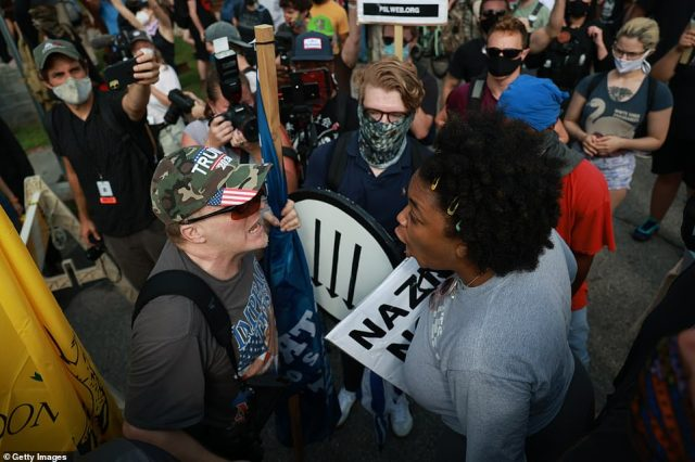 A man wearing a Trump 2020 cap was seen arguing with a woman protesting against racism and white supremacy
