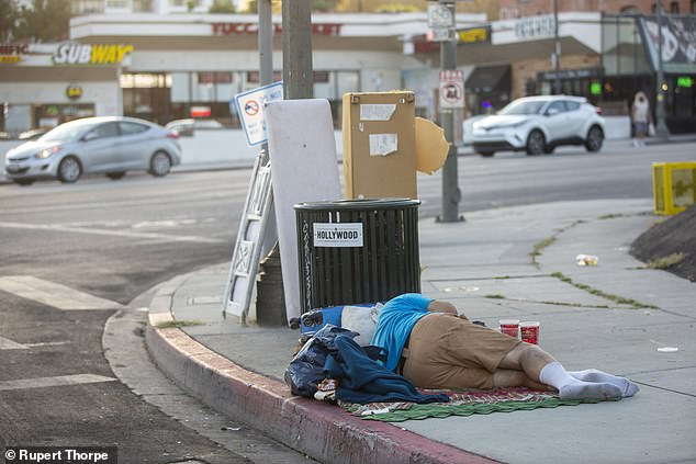 A homeless man on Hollywood¿s Walk Of Fame.Junkies and the homeless, many of whom are clearly mentally ill, walk the palm-lined streets like zombies ¿ all just three blocks from multi-million-dollar homes overlooking the Pacific