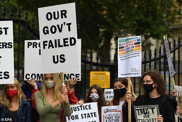 A-level results have been thrown into chaos this year after almost 40 per cent of students had their results downgraded. Pictured: Students protest outside 10 Downing Street in London