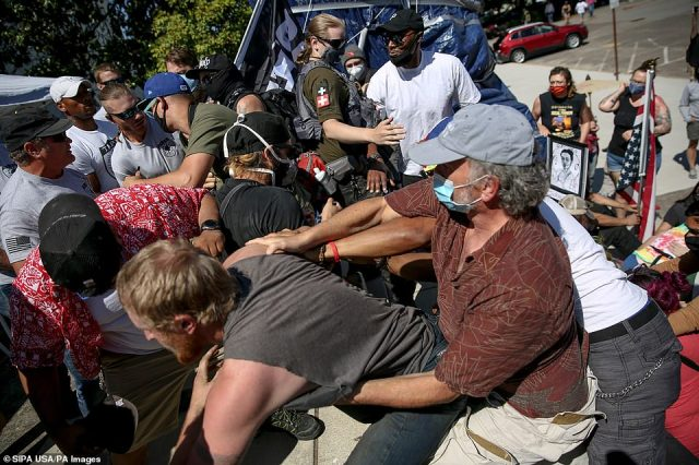 A fight breaks out between Black Lives Matter protesters and demonstrators with the Open Up Oregon Rally protest