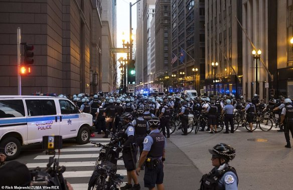 Large numbers of Chicago police officers, many on bicycles, swarmed the center of the city to kettle protesters