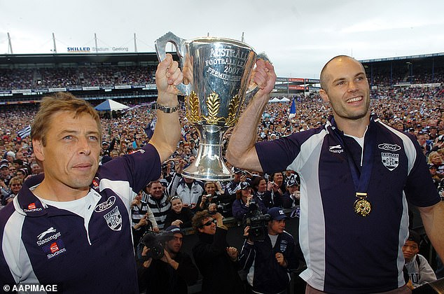 Mark Thompson (pictured left) with Geelong Cats captain Tom Harley after winning the 2007 AFL Grand Final at the MCG