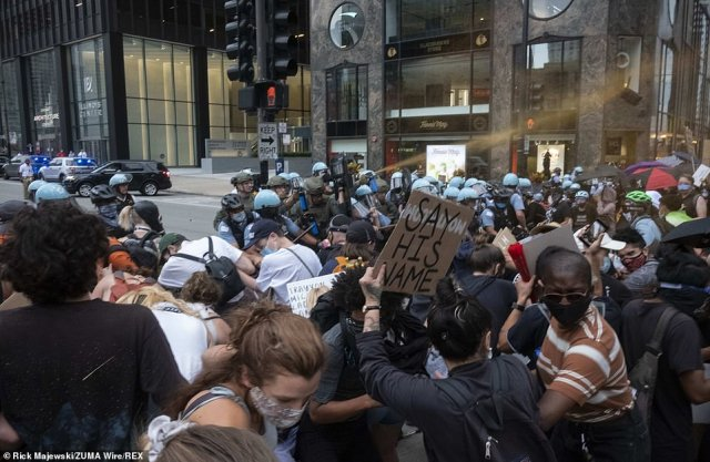 Police pepper spray Black Lives Matter protesters in Chicago on Saturday evening at the end of a day of rallies