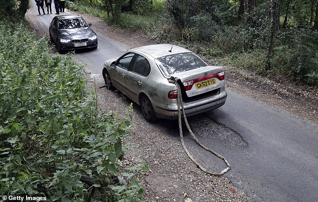 Pictured: The Seat Toledo with the tow rope that dragged the officer to his death on August 15, 2019