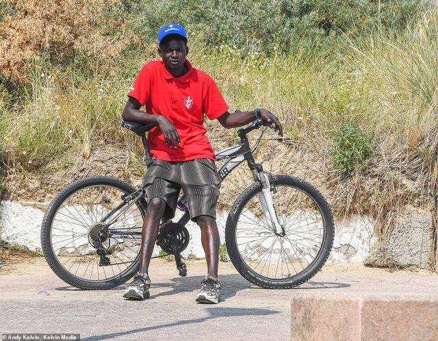 As they while away their time pointing to ferries passing between Calais and England, they are joined by their 16-year-old countryman Yahya Idriss, from faraway Sudan, riding a bicycle given to him by a local charity