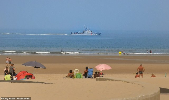 A French Maritime Gendarmerie Coastal Patrol ship is pictured off the shore of Bleriot Beach