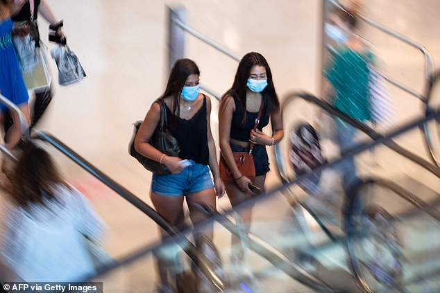 Last week, it was revealed that Paris and Marseille had experienced major epidemics of the virus.  Pictured: People wear face masks as they enter a Marseille shopping center