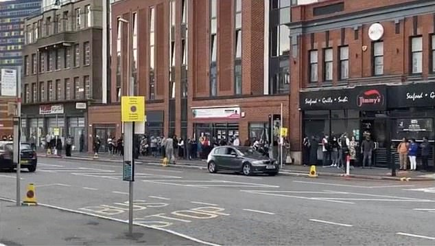Concerned police in Leicester have been forced to use emergency powers to break up huge crowds eagerly waiting to take restaurants up on their offer. Pictured: People queuing for restaurants on London Road