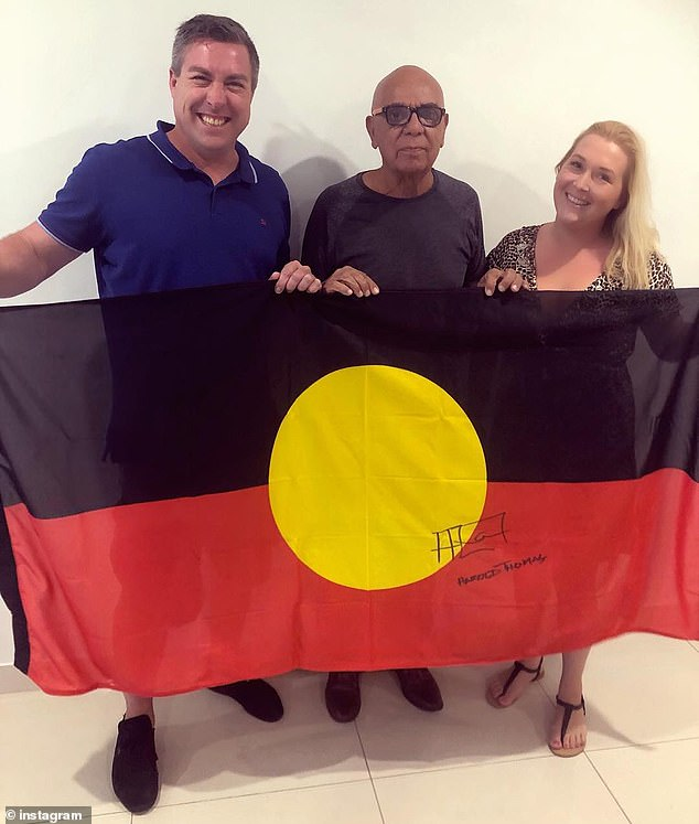 Ben Wooster (left) and Semele Moore (right) with Aboriginal Flag designer Harold Thomas (centre) after their company WAM Clothing was given a copyright license in 2018