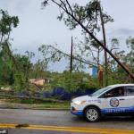 Florida city is flattened by possible tornado that downed lines, uprooted trees and flooded streets