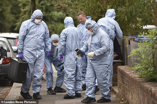 Forensic teams arrive at the scene in Acton, west London, where a 10-year-old boy has been found dead