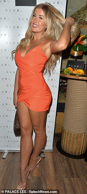 Vibrant: Jess Gale arrived with her twin Eve and turned heads in an orange mini dress