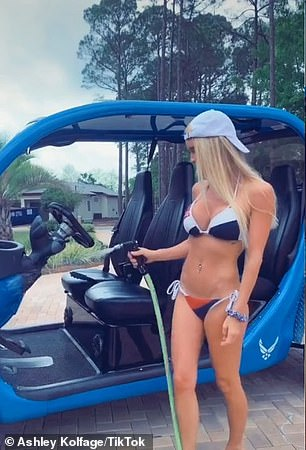 One of the things prosecutors claim the pair spent the stolen money on was this golf cart that Ashley is seen washing in a TikTok video