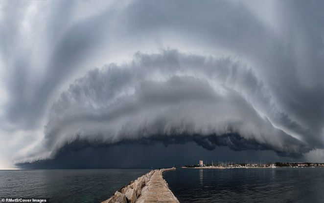 'This monster shelf cloud was perhaps the most beautiful structure and size over my area. I was waiting for two hours for the cloud to arrive and then it made a real mess', said photographer Maja Kraljik of the image that was taken inUmag, Croatia. It shows large swelling clouds over the town's harbour
