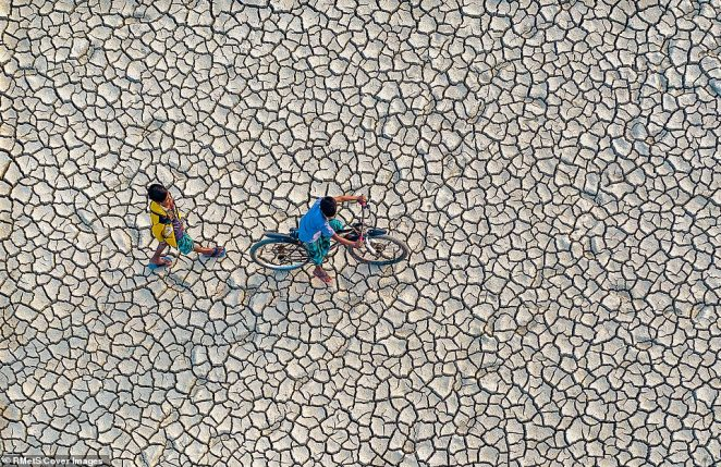 'In winter the water level drops and cultivable lands get dry causing serious drought. In some areas farmers can't even use water pumps to irrigate their lands. During the drought season people usually take fields as shortcuts to go from one village to another. I have tried to capture the scene in photos using my drone,' said Abdul Momin of the photograph he took inChittagong, Bangladesh