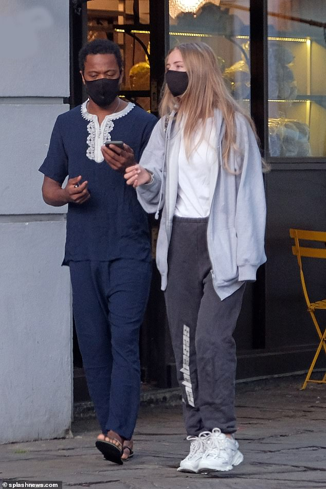 Discreet: She wore her blonde hair loose, while covering most of her face with a mask amid the coronavirus pandemic