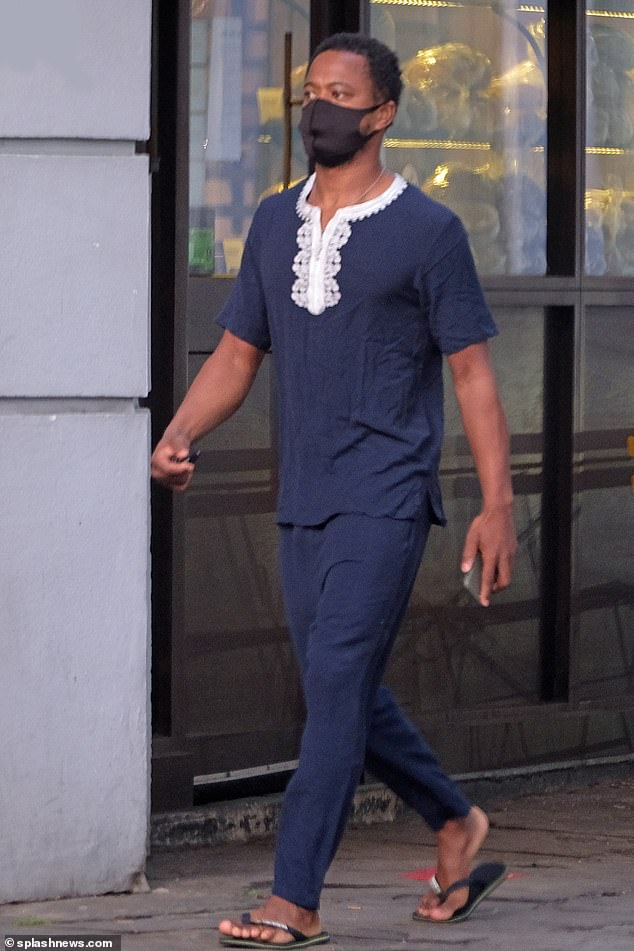 Walking around: Patrice was then seen walking without his model girlfriend