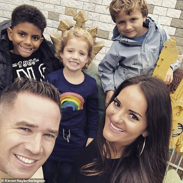 Cozy: The former stripper posed with their children Jett, seven, and Bunny, six, and their fiancee Michelle Penticost and son Valentino, 10, in a cozy magazine shoot