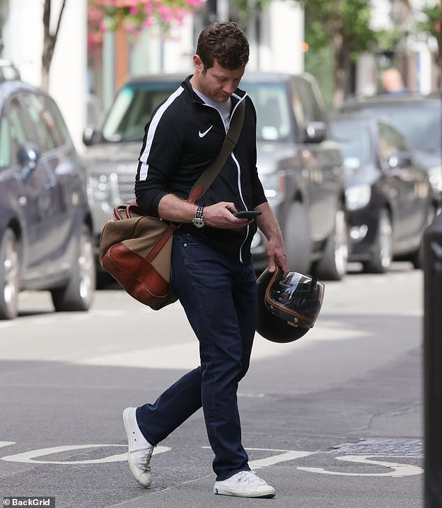 Downcast: The host was pictured looking downcast as he stepped out in London on Saturday