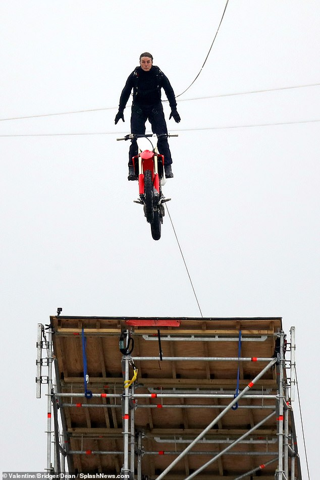 A frontal view of the dramatic stunt that saw Cruise jumping off a motorcycle at high speed as she hurtled down a ramp 500 feet into the air