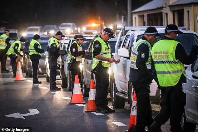 A police checkpoint at Albury on the NSW-Victorian border on July 8. It was the first time in 100 years the border was shut. Australia is split between those who want the suppression strategy blaming border closures for economic hardship and those who want elimination