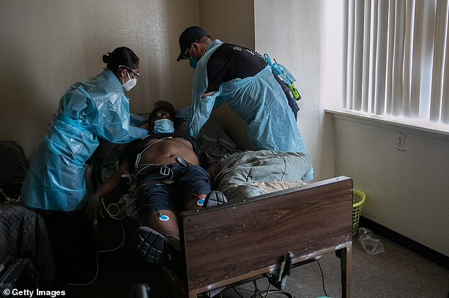A new study from Tulane University looked at hospitalized coronavirus patients with metabolic syndrome, which occurs when someone has three out of the five conditions: high blood sugar, hypertension, high triglycerides, low HDL cholesterol and obesity. Pictured: EMS medics help a man with COVID-19 symptoms before transporting him to a hospital in Houston, August 14