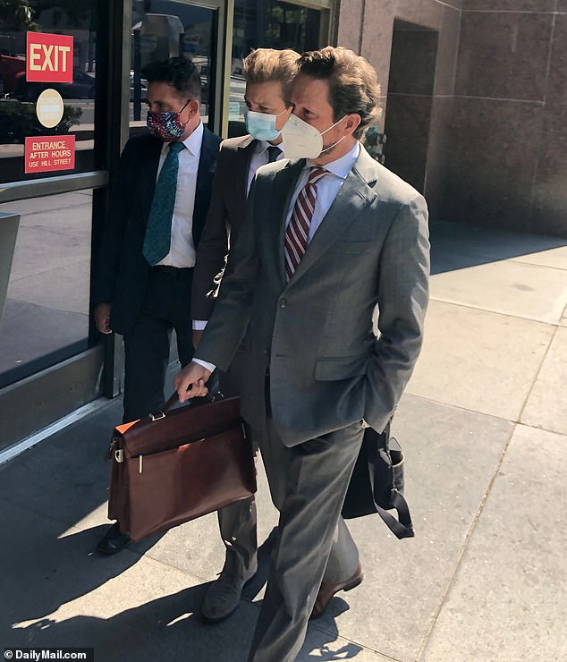 Jeremy Renner (center) appeared at LA court last month and now claims he's lost millions due to Hollywood productions being shuttered during the coronavirus pandemic