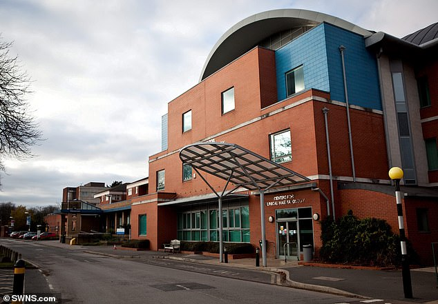 The woman later died and is understood to have been the first fatality recorded by University Hospitals Nottingham NHS Trust, on March 3. (Pictured: City Hospital which is run by the trust)