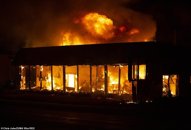 he State of Wisconsin Department of Corrections building burns as flames engulf the facility that was set on fire by protesters over the police shooting of Jacob Blake