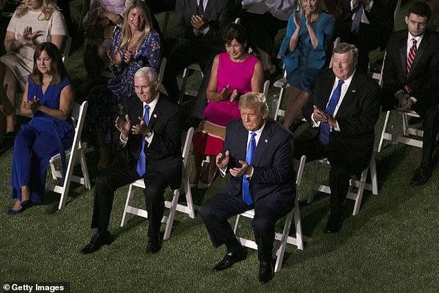 President Donald Trump, Vice President Mike Pence and his wife Karen Pence, (R-L, second row) Viktor Knavs and Amalija Knavs, parents of the first lady Melania Trump, listen to the first lady's address to the Republican National Convention from the Rose Garden at the White House on August 25, 2020 in Washington, DC