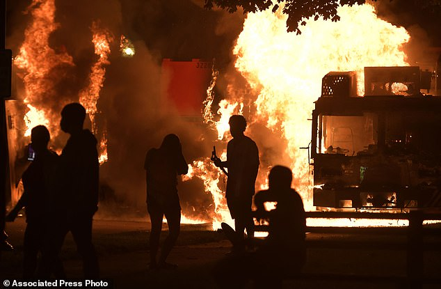 Wisconsin's governor summoned the National Guard to head off another round of violent protests Monday after the police shooting of an unarmed black man in Kenosha turned the city into the nation's latest flashpoint in a summer of racial unrest