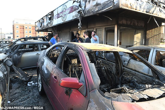 Shocking pictures from downtown Kenosha captured on Monday showed dozens of burned out cars lining the streets, several businesses decimated by vandalism and numerous others looted