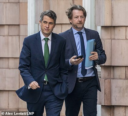 Mr Williamson, pictured in Whitehall this morning, said'we always follow and listen to the best scientific and medical advice, and that's why we're not recommending that face coverings should be mandatory right across the country in all schools'