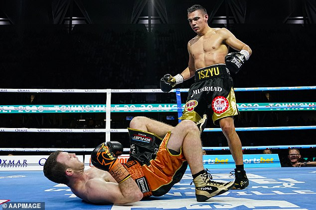 The 32-year-old (left) suffered a crushing defeat to Tim Tszyu (right)  in Townsville a fortnight ago