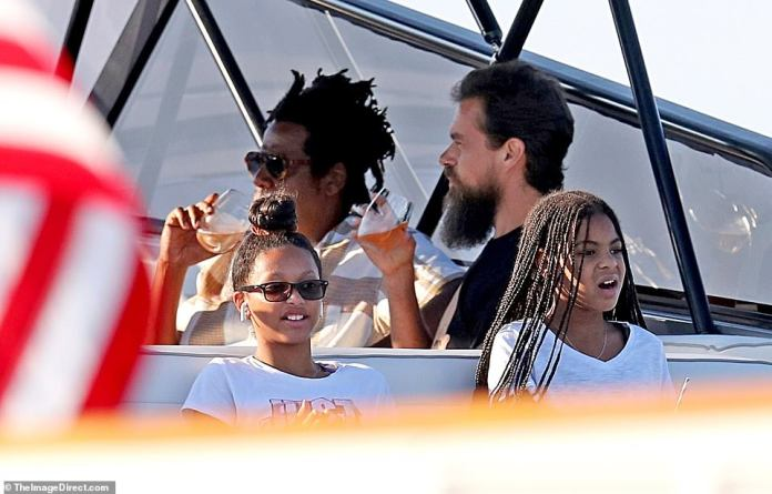 Bump encounter: Jay and Twitter CEO Jack Dorsey is seen sipping rosé wine, while daughter Blue Ivy and a friend sit outside