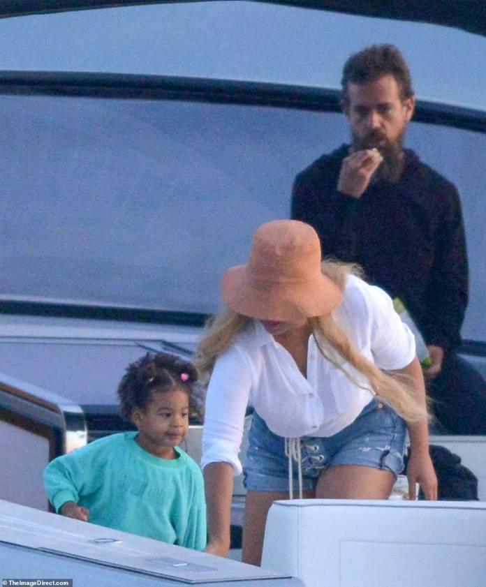 Cute: Bey is seen helping her daughter Rumi, as Twitter's Jack enjoys a snack behind her