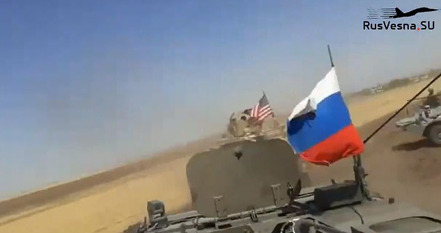 Russian presence: One still from the video shows how the Russian armored vehicle which rammed the American troop-carrier was not alone - at the right is another armored Russian vehicle