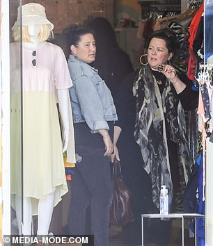 Melissa appeared to be joined by a pal during the shopping spree