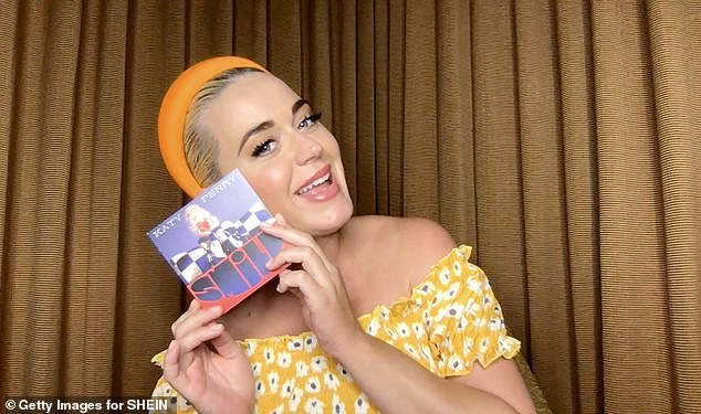 Dedicated: Katy Perry - pictured last week - admitted she was celebrating the release of her new album 'from her hospital bed' after giving birth this week