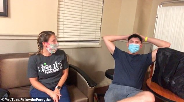 Waiting: Once at the hospital, she changed into her gown and she, Austin, and Rachel all wore masks in the room while they waited for active labor to start