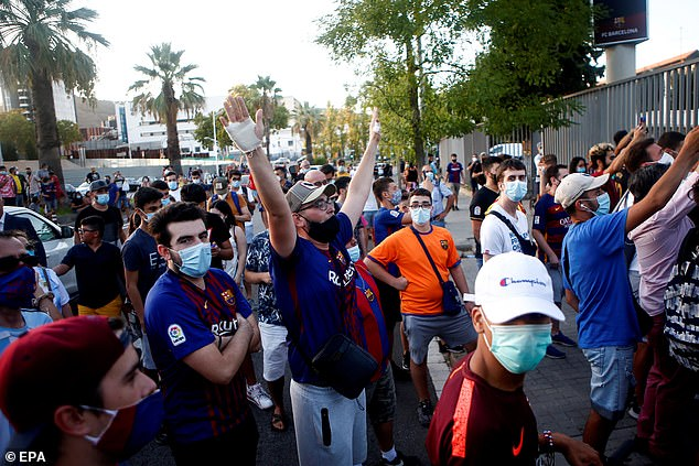 Barcelona supporters gathered around Camp Nou to protest their commission under fire