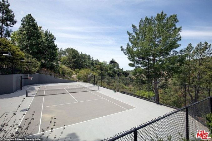 Stretching their legs: Justin and Hailey can even play a game of tennis on their backyard court