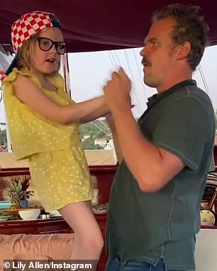 Shaking a leg: In the video, the Stranger Things star is seen holding the youngster in dance pose as he rocks with her to and fro while Bruno Mars' Uptown Funk plays in the background