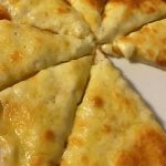 Home cook wows with her VERY simple three-ingredient recipe for an oozing cheesy garlic pizza